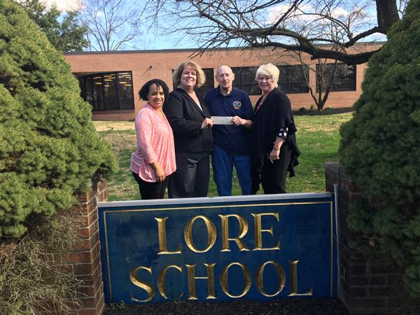 Ewing Kiwanis Club Presenting LPA with Check to Purchase Books for Lore Students